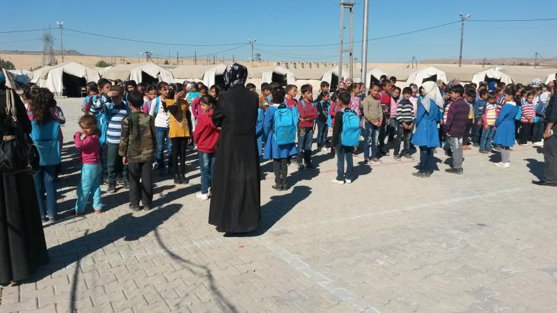 Children singing free Syrian anthem in the Nizip camp
